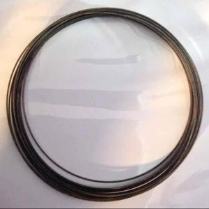"Other - 20-loop coil of bronze memory wire: 4.5"" × 1 mm"